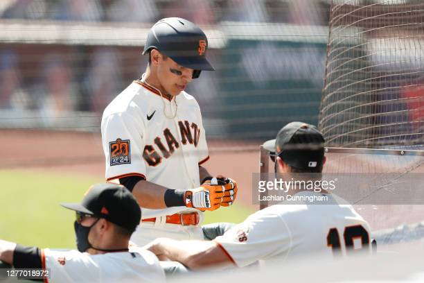 Mauricio Dubon of the San Francisco Giants celebrates with Gabe Kapler after hitting a solo home run in the bottom of the second inning against the...