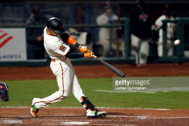 Mauricio Dubon of the San Francisco Giants hits a three-run home run in the bottom of the fifth inning against the Colorado Rockies at Oracle Park on...