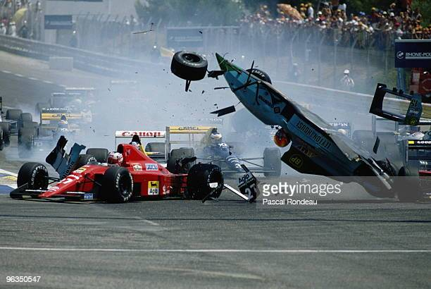 Mauricio Gugelmin driving the Leyton House March Judd CG891 collides with Nigel Mansell at the start of the French Grand Prix on 9th July 1989 at the...