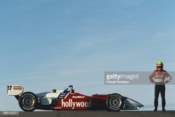Mauricio Gugelmin of Brazil driver of the Hollywood PacWest Reynard 97i MercedesBenz IC108D V8t poses for a photograph during practice for the...