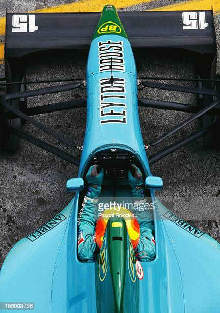 Mauricio Gugelmin of Brazil sits aboard the Leyton House Racing Leyton House CG911 Ilmor V10 holding the Momo steering wheel during practice for the...