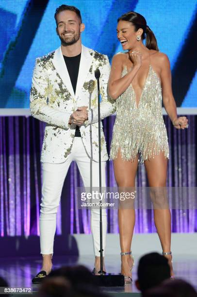 Mauricio Henao and Zuleyka Rivera on stage at Telemundo's 2017 'Premios Tu Mundo' at American Airlines Arena on August 24 2017 in Miami Florida