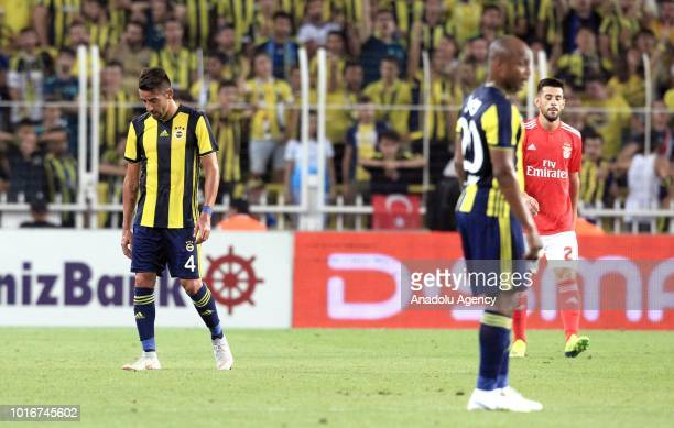 Mauricio Isla and Andre Ayew of Fenerbahce gesture after the goal of Benfica during UEFA Champions League third qualifying round's second leg match...