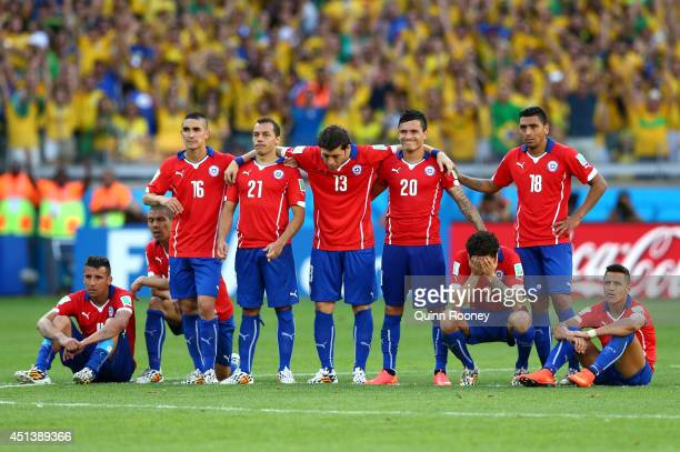Mauricio Isla Francisco Silva Felipe Gutierrez Marcelo Diaz Jose Rojas Charles Aranguiz Eugenio Mena Gonzalo Jara and Alexis Sanchez of Chile look on...