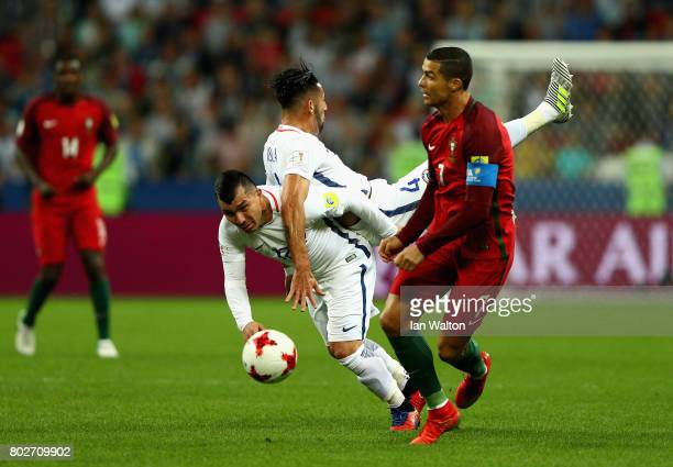 Mauricio Isla of Chaile nd Gary Medel of Chile colide as Cristiano Ronaldo of Portugal gets away during the FIFA Confederations Cup Russia 2017...
