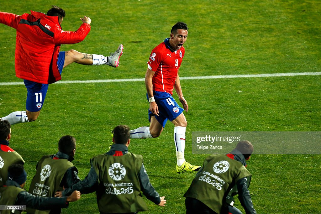 Mauricio Isla of Chile celebrates after scoring the opening goal during the 2015 Copa America Chile quarter final match between Chile and Uruguay at Nacional Stadium on June 24, 2015 in Santiago, Chile.