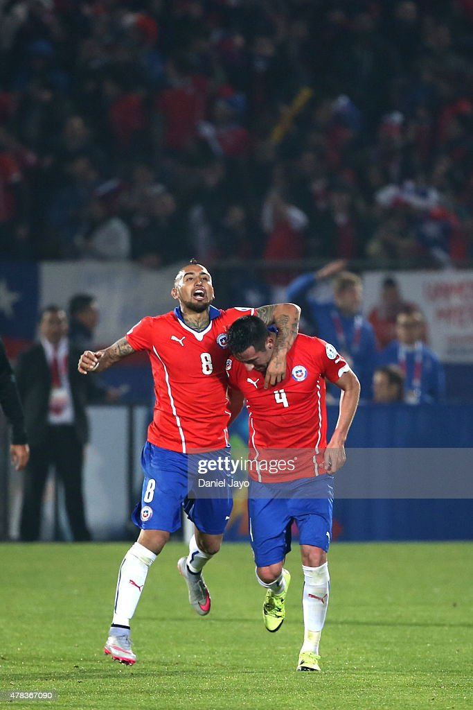 Mauricio Isla of Chile celebrates with teammate Arturo Vidal after scoring the opening goal during the 2015 Copa America Chile quarter final match between Chile and Uruguay at Nacional Stadium on June 24, 2015 in Santiago, Chile.