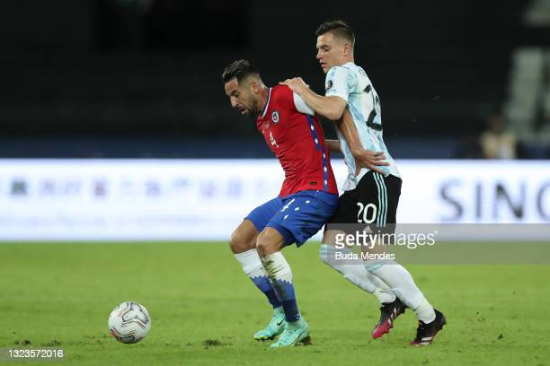 Mauricio Isla of Chile competes for the ball with Giovani Lo Celso of Argentina during a Group A match between Argentina and Chile at Estadio...