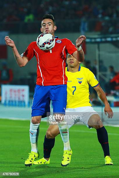 Mauricio Isla of Chile controls the ball as Jefferson Montero of Ecuador tries to stop him during the 2015 Copa America Chile Group A match between...