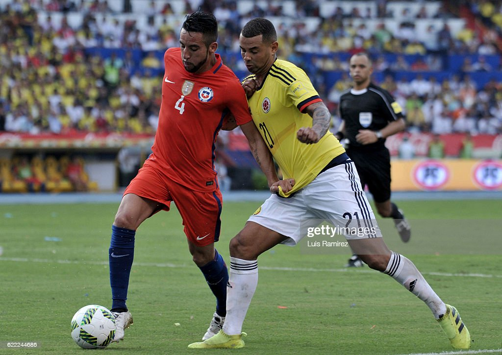 Mauricio Isla of Chile fights for the ball with Edwin Cardona of Colombia during a match between Colombia and Chile as part of FIFA 2018 World Cup Qualifiers at Metropolitano Roberto Melendez Stadium on November 10, 2016 in Barranquilla, Colombia.