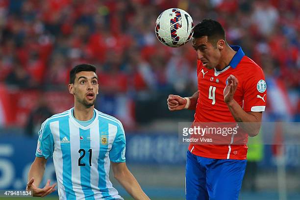 Mauricio Isla of Chile heads the ball during the 2015 Copa America Chile Final match between Chile and Argentina at Nacional Stadium on July 04 2015...