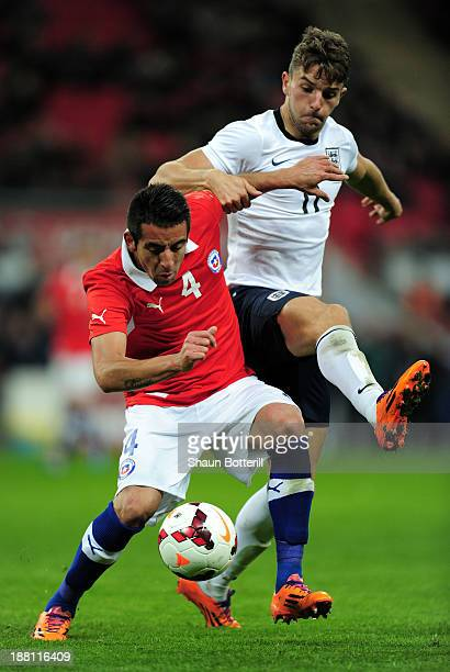 Mauricio Isla of Chile holds off Jay Rodriguez of England during the international friendly match between England and Chile at Wembley Stadium on...