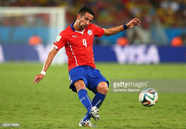 Mauricio Isla of Chile kicks the ball during the 2014 FIFA World Cup Brazil Group B match between Chile and Australia at Arena Pantanal on June 13...