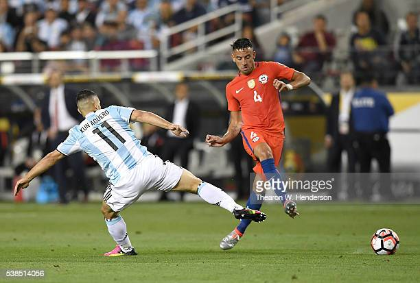 Mauricio Isla of Chile kicks the ball past Sergio Aguero of Argentina during the 2016 Copa America Centenario Group match play between Argentina and...