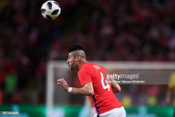 Mauricio Isla of Chile shoots a header during the International Friendly match between Sweden and Chile at Friends arena on March 24 2018 in Solna...
