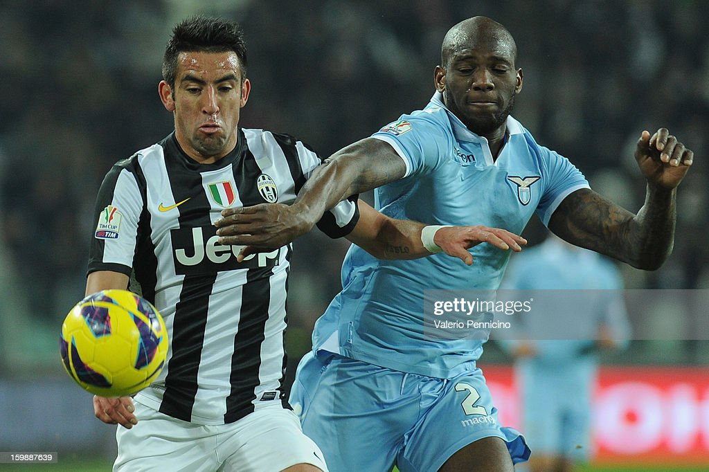 Mauricio Isla (L) of Juventus FC competes with Michael Ciani of S.S. Lazio during the TIM cup match between Juventus FC and S.S. Lazio at Juventus Arena on January 22, 2013 in Turin, Italy.