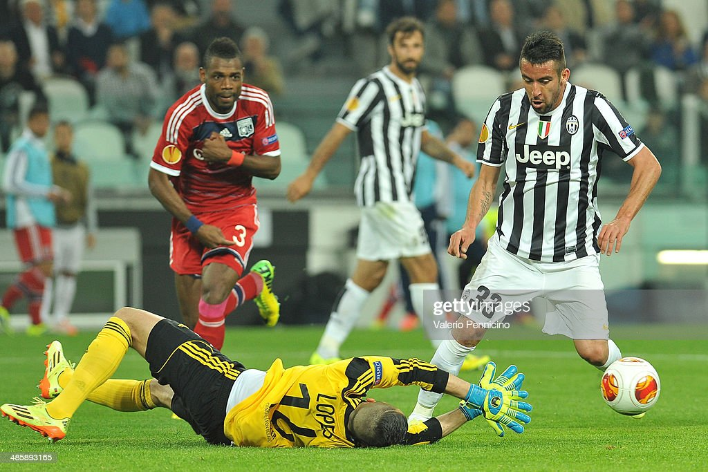 Mauricio Isla (R) of Juventus is tackled by Anthony Lopes of Olympique Lyonnais durig the UEFA Europa League quarter final match between Juventus and Olympique Lyonnais at Juventus Arena on April 10, 2014 in Turin, Italy.