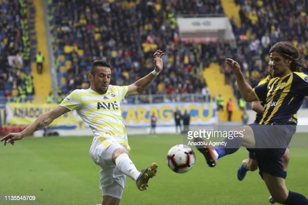 Mauricio Isla of MKE Ankaragucu and Pinto of Fenerbahce vie for the ball during Turkish Super Lig soccer match between MKE Ankaragucu and Fenerbahce...