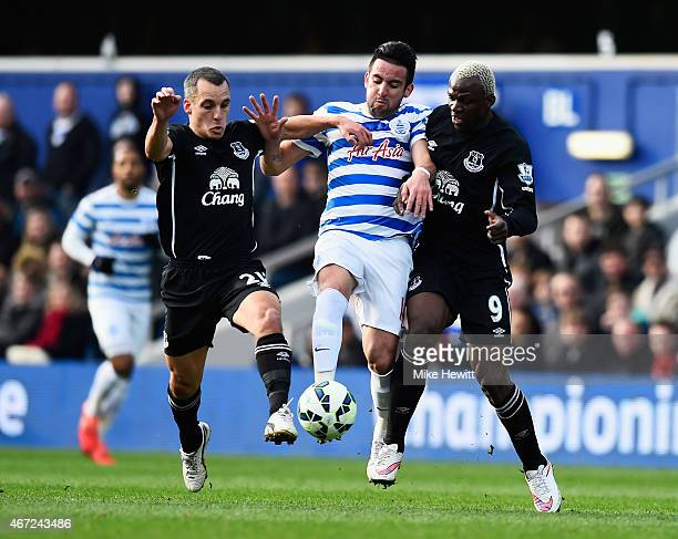 Mauricio Isla of QPR is challenged by Leon Osman and Arouna Kone of Everton during the Barclays Premier League match between Queens Park Rangers and...