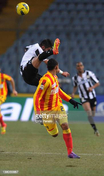 Mauricio Isla of Udinese competes with Luis Muriel of Lecce during the Serie A match between Udinese Calcio and US Lecce at Stadio Friuli on February...