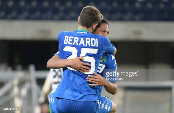 Mauricio Lemos of US Sassuolo celebrates with his teams mate Domenico Berardi after scoring his opening goal during the serie A match between Hellas...
