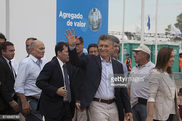 Mauricio Macri Argentina's president center waves to attendees during the inauguration of the Expoagro agricultural fair in Buenos Aires Argentina on...