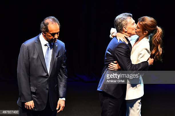 Mauricio Macri Mayor of Buenos Aires and presidential candidate for CAMBIEMOS and his wife Juliana Awada kiss each other after the Presidential...