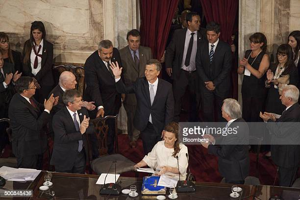 Mauricio Macri president of Argentina center waves to the crowd as he arrives to give his first speech to Congress in Buenos Aires Argentina on...