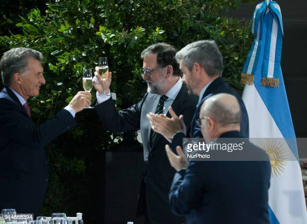 Mauricio Macri toasts with Mariano Rajoy while Marcos Peña Argentina's chief of staff and Jorge Faurie Minister of Foreign Affairs and Worship watch...