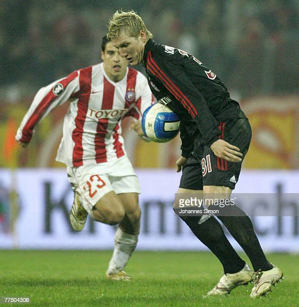 Mauricio Molina of Belgrade and Bastian Schweinsteiger of Bayern in action during the UEFA Cup group F match between Crvena Zvezda and Bayern Munich...