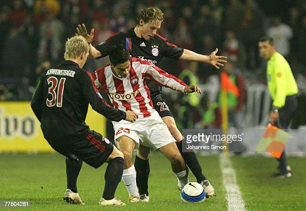 Mauricio Molina of Belgrade and Marcell Jansen and Bastian Schweinsteiger of Bayern in action during the UEFA Cup group F match between Crvena Zvezda...