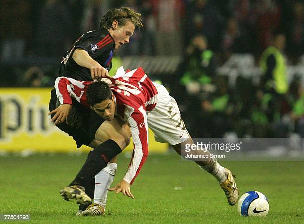 Mauricio Molina of Belgrade and Marcell Jansen of Bayern action during the UEFA Cup group F match between Crvena Zvezda and Bayern Munich at Crvena...