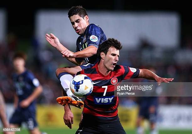 Mauricio Molina of FC Seoul competes for the ball against Labinot Haliti of the Wanderers during the Asian Champions League semi final leg 2 match...