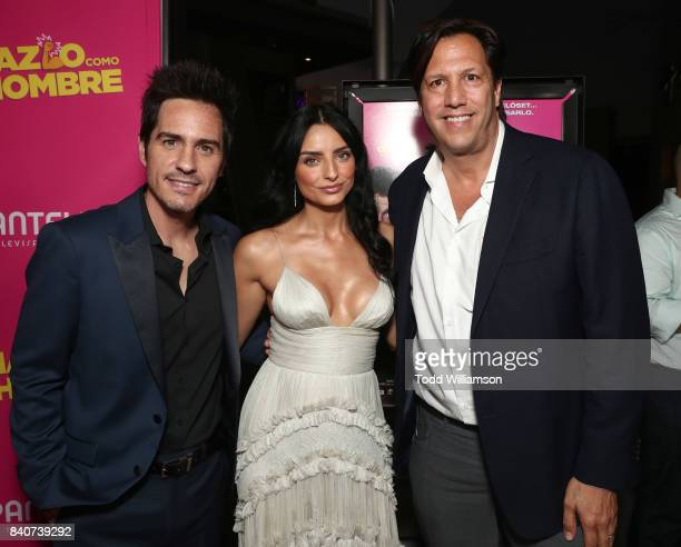 Mauricio Ochmann Aislinn Derbez and Pantelion CEO Paul Presburger attend the 'Hazlo Como Hombre' Los Angeles Premiere at ArcLight Hollywood on August...
