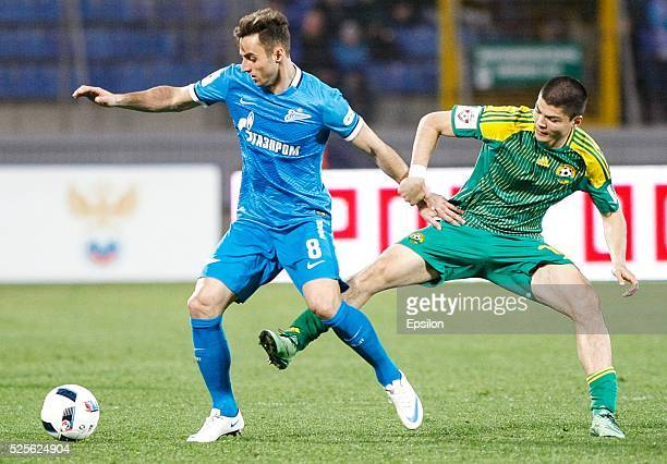 Mauricio of FC Zenit St Petersburg and Arsen Khubulov of FC Kuban Krasnodar vie for the ball during the Russian Football League match between FC...