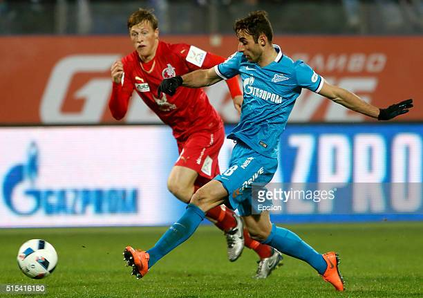 Mauricio of FC Zenit St Petersburg and Emil Bergstrom of FC Rubin Kazan vie for the ball during the Russian Football League match between FC Zenit St...