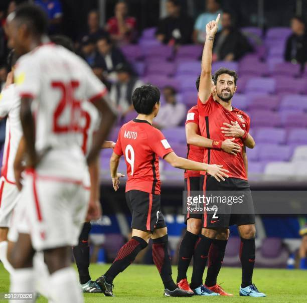 Mauricio of Japan's Urawa Reds is congratulated by teammates after scoring his second goal of the Club World Cup match for fifth place against...