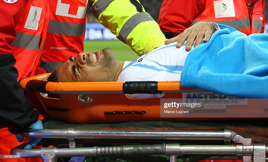 Mauricio of SS Lazio is helped from the pitch after sustaining an injury during the TIM Cup match between AC Milan and SS Lazio at Stadio Giuseppe Meazza on January 27, 2015 in Milan, Italy.