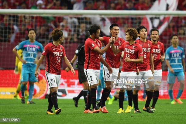 Mauricio of Urawa Red Diamonds celebrates scoring his side's first goal with his team mates during the JLeague J1 match between Urawa Red Diamonds...