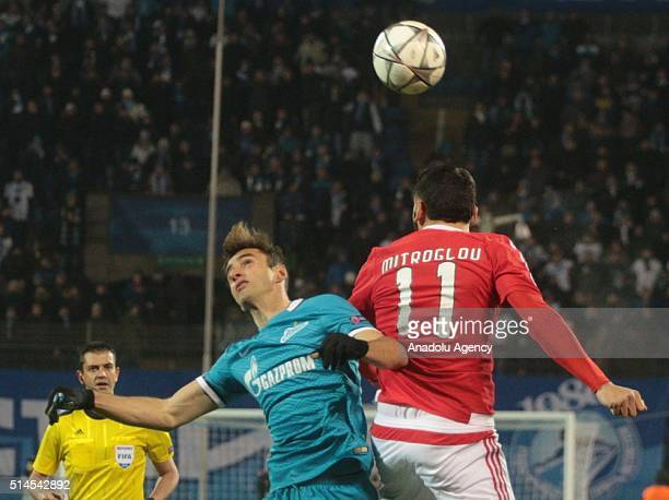 Mauricio of Zenit StPetersburg in action against Kostas Mitroglou of SL Benfica during the UEFA Champions League round 16 secondleg football match...