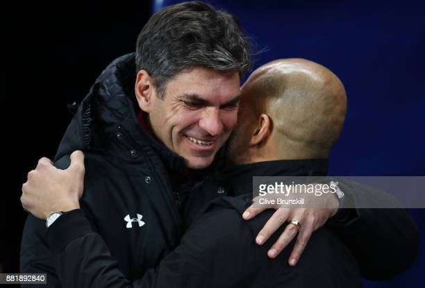 Mauricio Pellegrino Manager of Southampton and Josep Guardiola Manager of Manchester City greet each other during the Premier League match between...