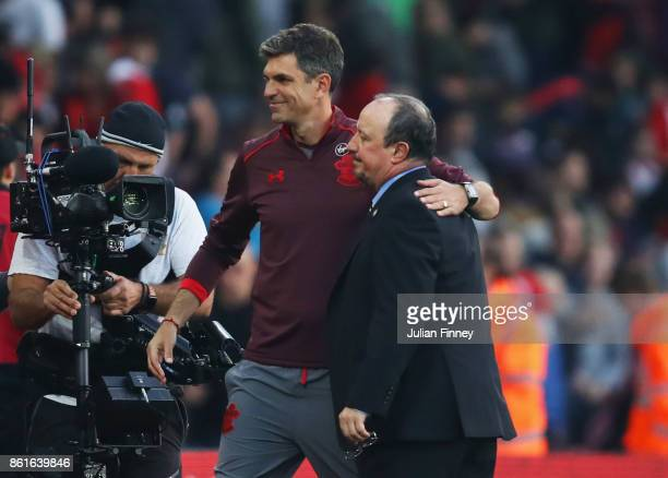 Mauricio Pellegrino Manager of Southampton and Rafael Benitez Manager of Newcastle United embrace at full time the Premier League match between...