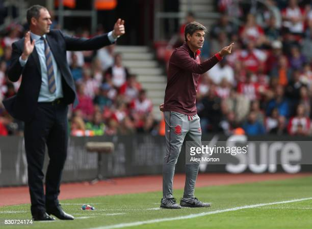 Mauricio Pellegrino Manager of Southamton and Paul Clement Manager of Swansea City direct their teams during the Premier League match between...