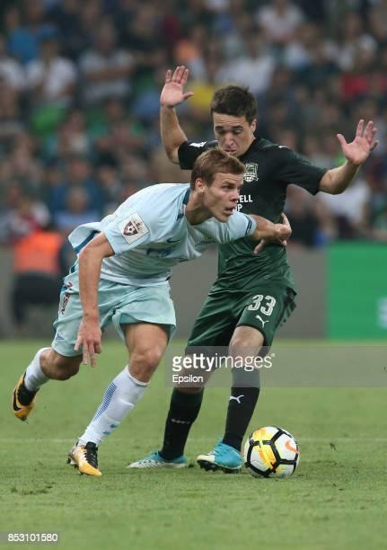Mauricio Pereyra of FC Krasnodar is challenged by Aleksandr Kokorin of FC Zenit St Petersburg during the Russian Premier League match between FC...