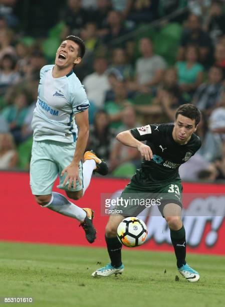 Mauricio Pereyra of FC Krasnodar is challenged by Matias Kranevitter of FC Zenit St Petersburg during the Russian Premier League match between FC...