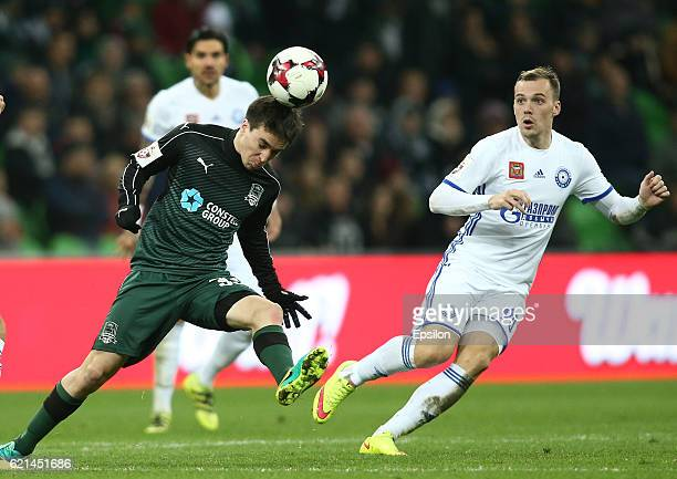 Mauricio Pereyra of FC Krasnodar is challenged by Sergei Breyev and Artyom Delkin of FC Orenburg during the Russian Premier League match between FC...
