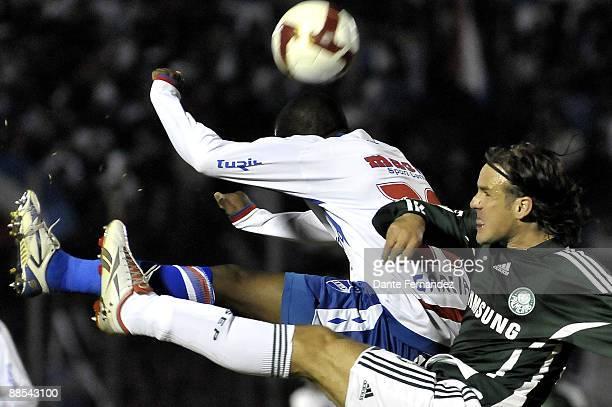 Mauricio Pereyra of Uruguay's Nacional vies for the ball with Marcao of Brazil's Palmeiras during their quarter final round match of the Santander...