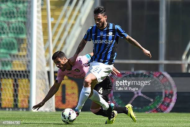 Mauricio Pinilla of Atalanta and Sinisa Andelkovic of Palermo compete for the ball during the Serie A match between US Citta di Palermo and Atalanta...