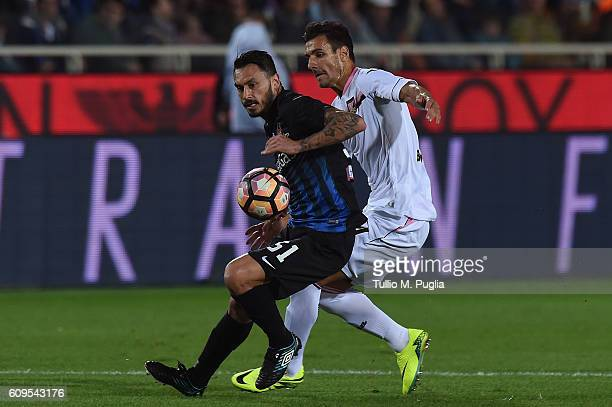 Mauricio Pinilla of Atalanta and Sinisa Andelkovic of Palermo compete for the ball during the Serie A match between Atalanta BC and US Citta di...