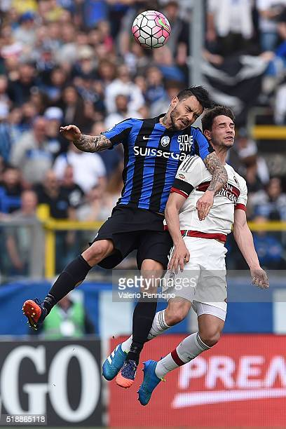 Mauricio Pinilla of Atalanta BC clashes with Mattia De Sciglio of AC Milan during the Serie A match between Atalanta BC and AC Milan at Stadio Atleti...